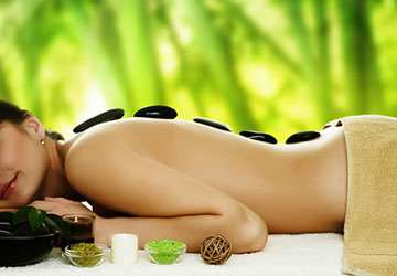 Woman enjoying stones spa treatment.