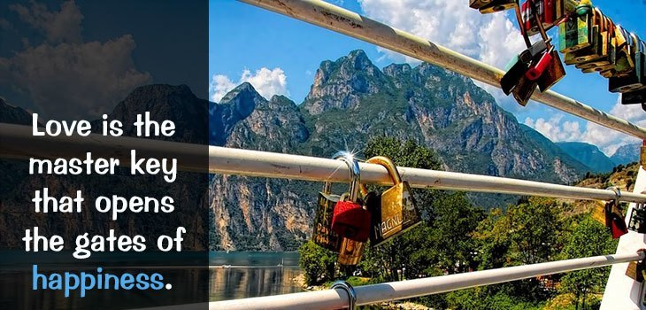 Quote: Love is the master key that opens the gates of happiness. Image of locks locked on a bridge to symbolize eternal love between couples.
