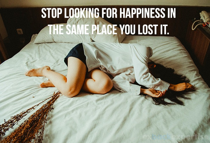 """Image of what to do after a breakup with quote """"stop looking for happiness in the same place you lost it"""""""